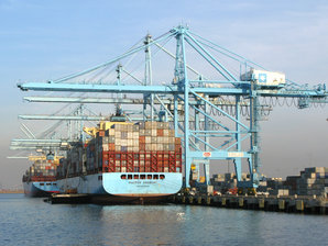 Ship in at the container terminal loaded by a STS Container Crane